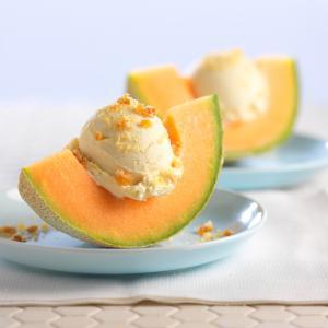 Cantaloupe Ice Cream : Ice cream cantaloupe with topping in cantaloupe fruit.